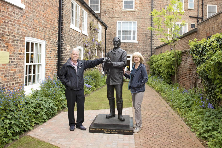 Daughter Rosie and son Jim with statue of Alf Wight.